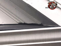 Gap between the wooden trim and the roof at a roof junction allowed bats into a house in Chattanooga Tennessee