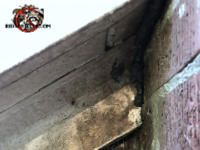 Gap between the stained wooden trim and the bricks of a house in Cordele Georgia was sealed with a heavy sealant to keep bats out of the attic