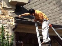 Bat control specialist on a ladder bat-proofing a house in Homewood, Alabama