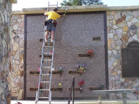 Technician sealing bats out of a mausoleum in Macon, Georgia