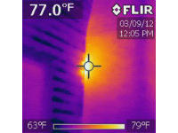 Bright spot on infrared photo pinpoints a honey bee nest in a chimney