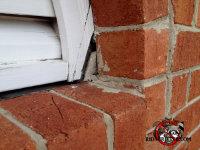 Flying squirrel entry gap in a loft vent in a brick building in Macon