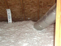 Freshly applied, bright white insulation installed in an attic in Homewood, Alabama