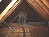 Men in attic of a Macon, Georgia home installing blown-in insulation