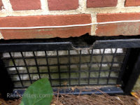 Mouse gnawing to a steel crawl space vent in Irondale, Alabama