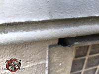 Plastic foundation vent cover with mouse gnaw marks on the top edge