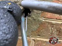 Quarter sized gap around pipes where they pass through a brick wall needs to be sealed to exclude mice from a Columbus Georgia home.