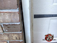 Half inch gap between the wooden garage door trim and the brick wall of a house in Chattanooga allowed mice to get in