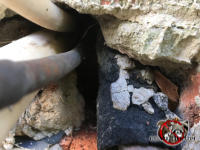 Gap in the brick wall where pipes pass through was sealed with mortar that crumbles and allowed mice into a house in Chattanooga