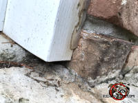Half inch gap between the vertical door frame and an expansion joint in the concrete needs to be sealed to keep mice out of a Dunwoody Georgia home.