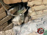 Gaping hole in the brick wall that allowed opossums into a house in Dunwoody Georgia will be temporarily sealed until the animals are removed and a bricklayer can do a permanent repair.