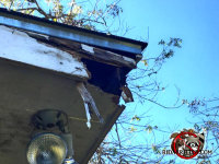 Raccoons gnawed and tore away the corner of the roof of a house in Quitman Georgia