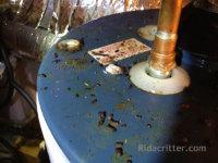 Rat droppings on a hot water heater at a Birmingham, AL rat control job