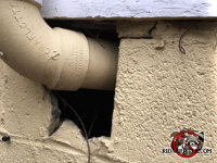 There is a large gap around a pipe passing through the cinder block foundation that rats used to get into the house