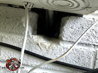 Square hole that seems to serve no purpose in the brick wall of a house in Dunlap Tennessee allowed rats into the house