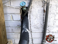 There is enough space in a pipe opening in the exterior brick wall for rats to get through