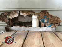 Rats badly tore apart the siding above the deck at a house in Hoover Alabama