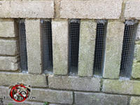 Screens installed on ventilation gaps in the brick foundation of a house in Hoover Alabama will help keep rats out of the crawl space.