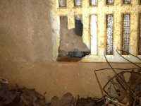 Rat hole chewed through a window frame into a crawl space in Gray, Georgia