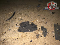 Rat droppings and torn tar paper on the floor in the unfinished attic of a house in Birmingham Alabama.