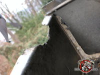 Bowl shaped hole about two inches across that squirrels gnawed into the top edge of a metal rain gutter on a house in Albany Georgia.