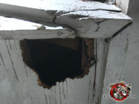 Baseball sized squirrel hole through the plywood soffit panel found at a squirrel removal job at a house in Hoover Alabama