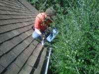 Squirrel control technician sealing squirrels out of a roof edge in Warrenton GA