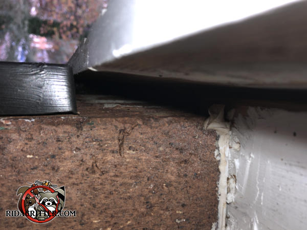 There is a gap of about half an inch between the top of the bricks and the roof trim
