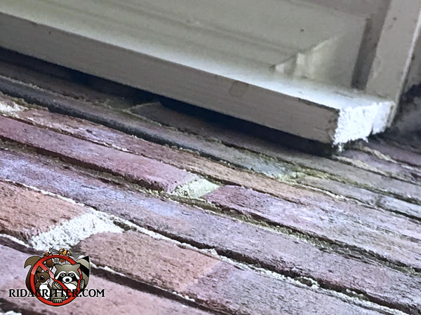 Gap of about a quarter inch between the wooden roof trim and the exterior brick work of the house