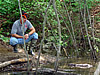 Technician by the water doing beaver trapping in Douglasville, Georgia