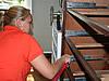 Female bedbug control exterminator killing bedbugs in a dresser