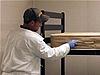 Exterminator treating a mattress for bedbugs