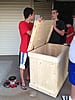 Boy Scouts inspecting an unfinished wood flag storage box