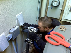 Animal control technician installing an animal-proof dryer vent