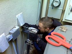 Animal control technician installing an animal-proof dryer vent