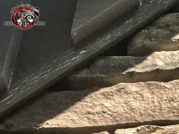 Gap between the stones under the rafter allowed flying squirrels to get into a stone house in Snellville Georgia