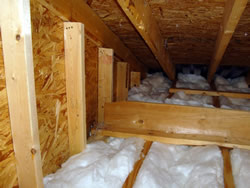Fresh, clean, white insulation in an attic in B1rmingham, Alabama