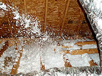 Insulation being blown into an attic looks like snow