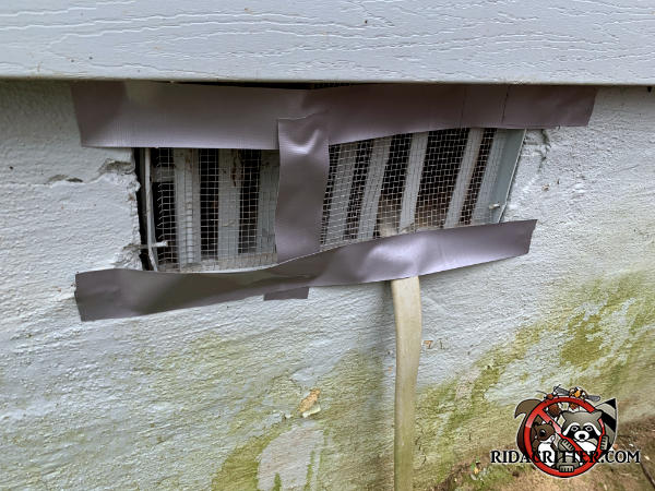 Someone tried using duct tape around the edge of a foundation vent to keep mice out of the crawl space of a house in Conyers Georgia