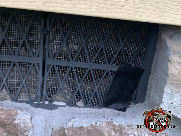 Homeowner applied a piece of duct tape about three inches long to the corner of a foundation vent to try to keep mice out of a house in Calhoun Georgia