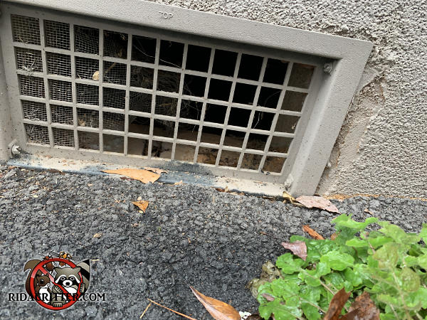 Two thirds of the screen behind a foundation vent has become detached and needs to be replaced to keep mice out of a house in Dallas Georgia.