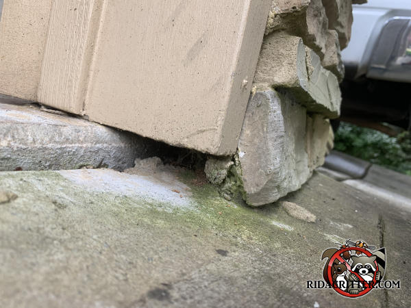Half inch gap under a wooden door frame will be sealed to keep mice out of a house in Canton, Georgia.