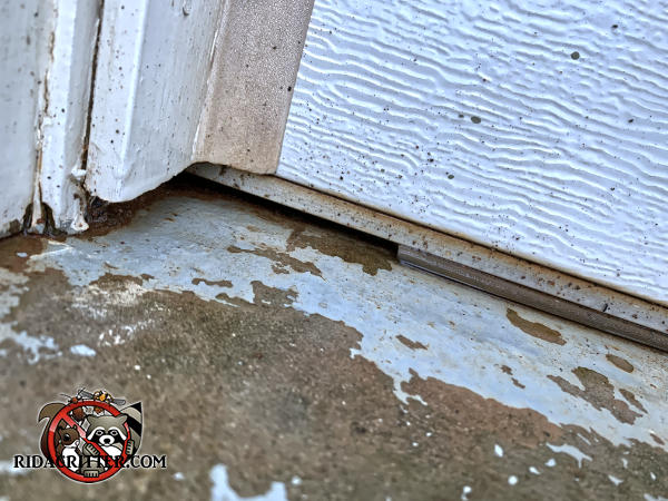 About six inches of the weather seal under a garage door are missing and the weather seal will have to be replaced to keep mice out of a garage in Temple Georgia