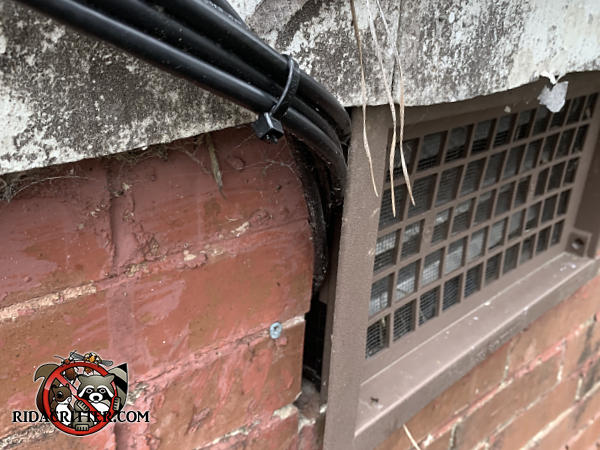 The cable TV installer pried the foundation vent away from the brick wall to pass wires behind it which allowed mice into a Macon Georgia home.