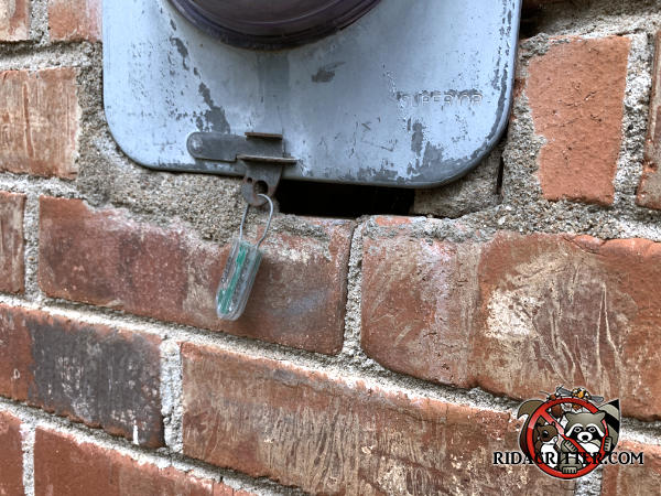 The mortar is missing from about two inches of the mortar joint under the electric meter and allowed mice into a house into a brick house in Lithia Springs Georgia