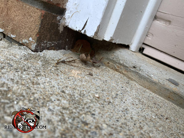 One inch gap at the bottom of the garage door trim needs to be sealed to keep mice out of a house in Roswell Georgia