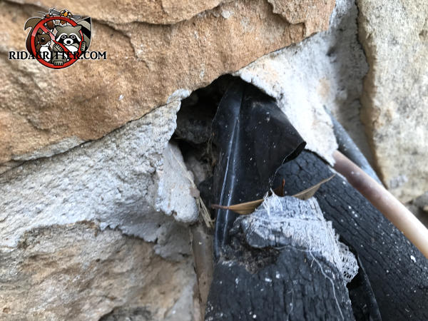 Gap around the air conditioning pipes where they pass through the stone wall needs to be sealed to keep mice out of a house in Valdosta Georgia.