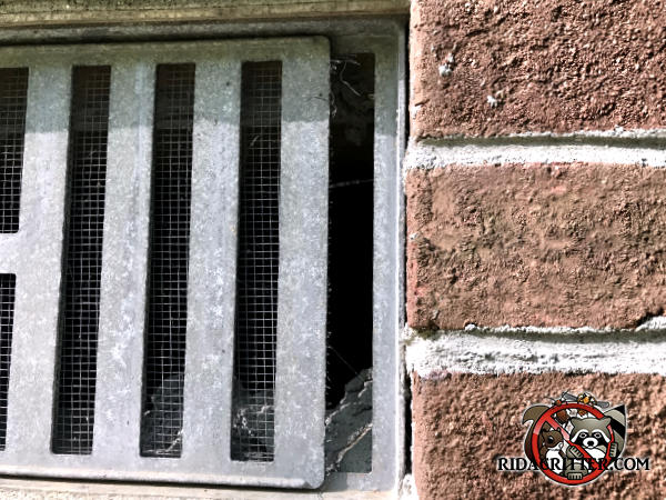 The metal foundation vent of a house in Bogart Georgia is slid open about half an inch and mice got in through the opening