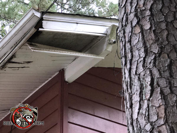 The end of the soffit panel is hanging down from the soffit at a house in College Park Georgia