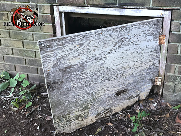 Plywood crawl space door about two feet square is rotted on the corner near the lower hinge and allowed rats into a house in Atlanta
